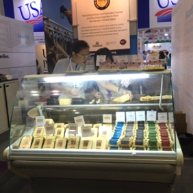 The USDEC booth at 2017 Food Hotel Vietnam features samples of Oregon's Face Rock Creamery and Utah's Beehive Cheese.