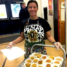 Toni Veeman served blueberry yogurt muffins as taste test for students at St. Paul Elementary.