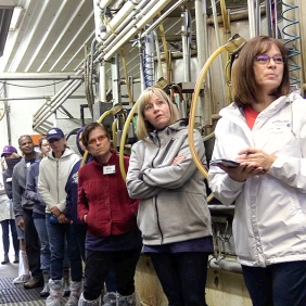 Tour group learning about the milking parlor